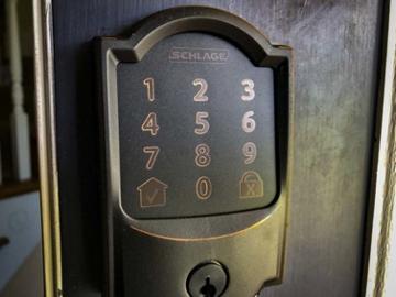 Schlage Encode Smart WiFi Deadbolt in Aged Bronze perfect for custom homes in Ottawa